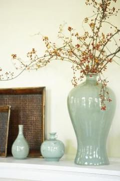 Decorate a foyer shelf with colorful vases.