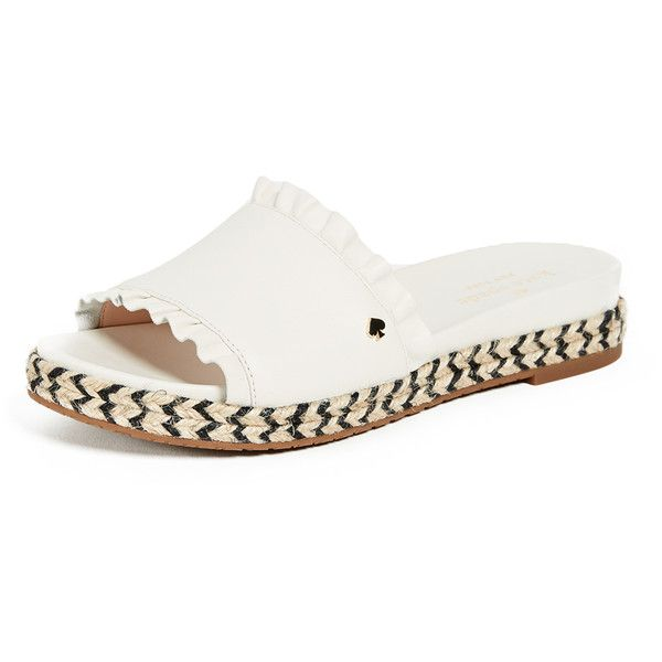 Leather: Sheepskin Ruffles Espadrille-style sidewalls Slide sandals Flat profile Open toe Rubber soles Imported, Vietnam This item cannot be gift-boxed