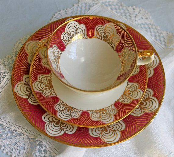 Antique Bavarian Porcelain Trio. Elgenbein Porcelain Cup, Saucer, Dessert Plate. Gold and Red Pattern over Cream Color Background.