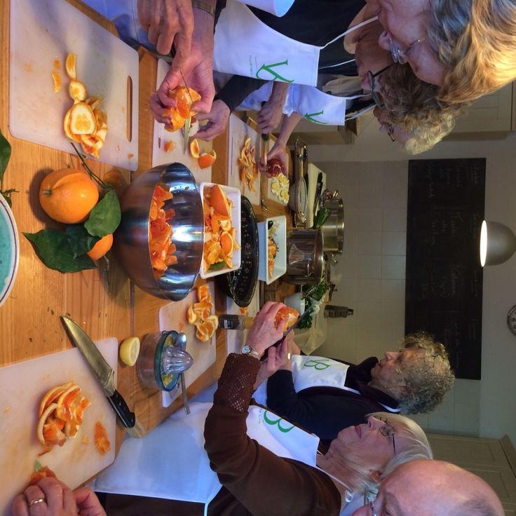 Preparing our orange Salad, sicilian cooking class in taormina , cooking in the kitchen at villa britania