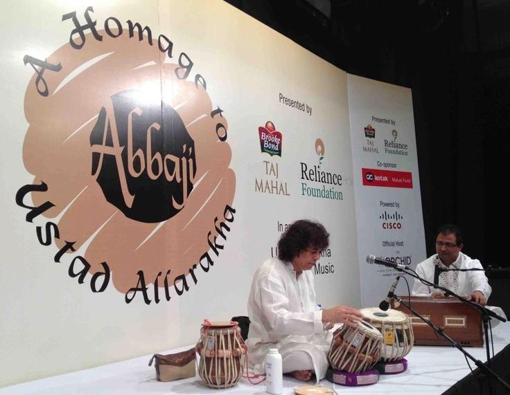 Zakir Hussain tunes his Tabla
