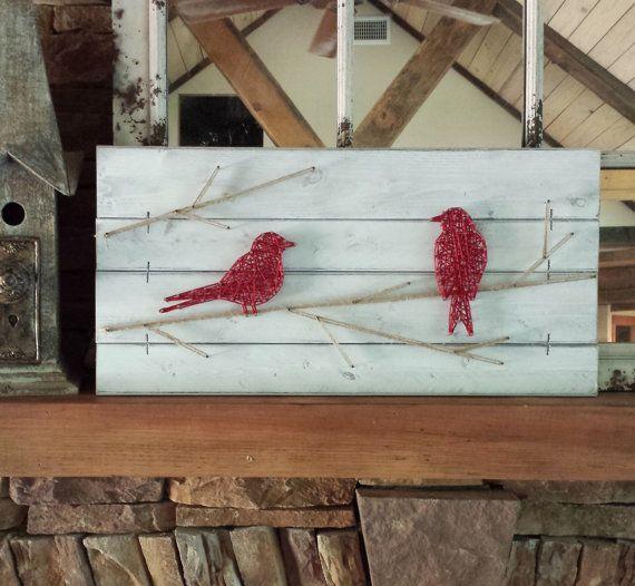 This unique bird artwork celebrates birds in farmhouse style! The string art bird is perfect for a rustic gallery wall, a nursery, a sunroom, a bedroom, or any room in the house that needs a touch of nature! Personalize your art - CHOOSE YOUR OWN COLORS! Two whimsical birds are nailed onto a wood slat canvas, which is painted (your choice of color from the sample board) and distressed, and then strung with your choice of string color for the birds. Jute is used for the branches. Ready to…