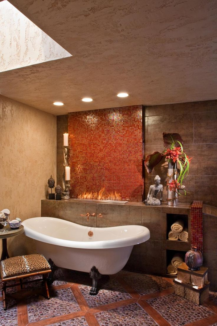 Many a spa would envy this luxurious bathroom where a clawfoot soaking tub  can be warmed