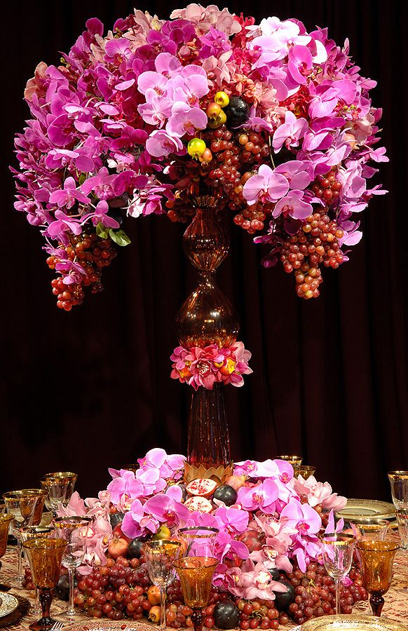 Large, phalaenopsis orchid and grape centerpiece.