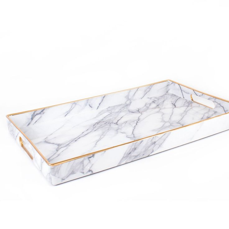 Marbled magnificence. Whether you're in need of containing your coffee table accessories or are looking to create the perfect breakfast in bed insta, this tray is where it's at. // dormify.com