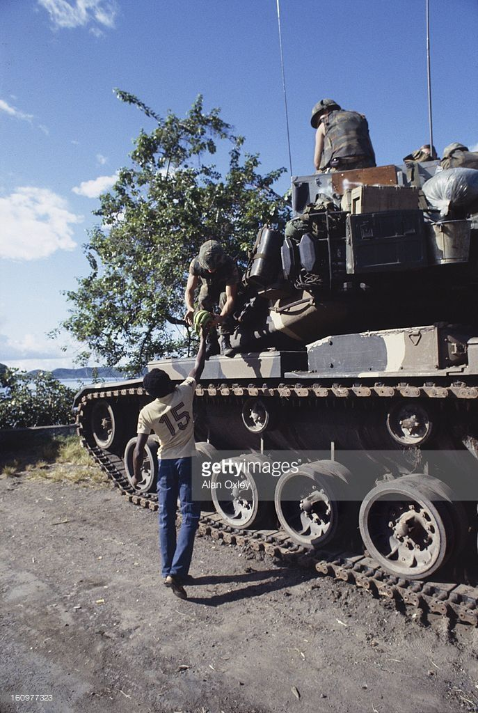 Army tank crew gets a gift of bananas from a local resident near St. Georges during the US invasion of Grenada (codenamed 'Operation Urgent Fury') in Oct, 1983.
