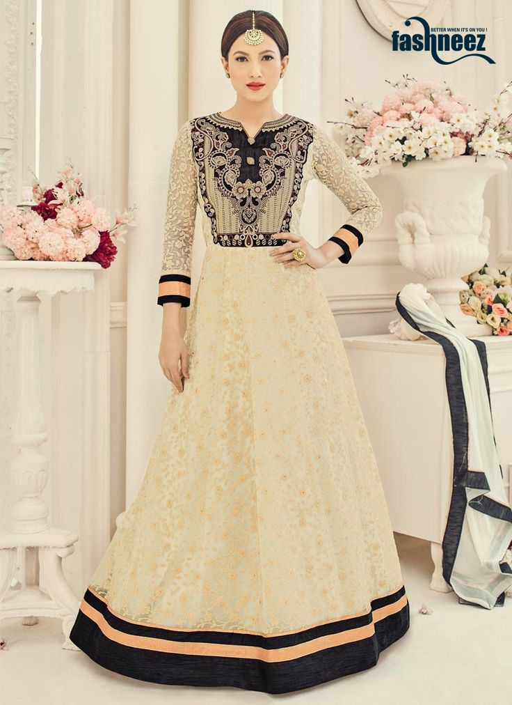 You are sure to make a strong fashion statement with this Gauhar Khan black and cream net floor length anarkali suit. This attire is beautifully adorned with embroidered, lace and resham work. Comes w...