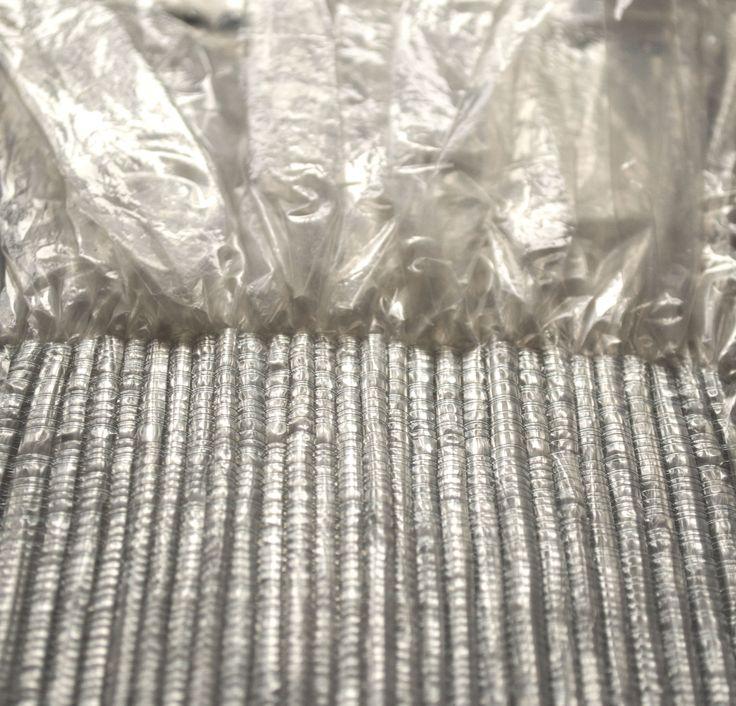Jess Coetzer textile artist.  plastic sheeting woven with nylon monofilament.  Experimental textiles