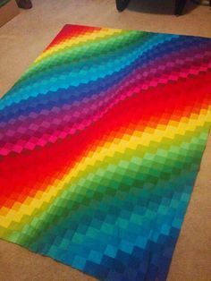 This looks hard, but the instructions are so simple.   This quilt used 2 jelly rolls of Kona Classic solid colors