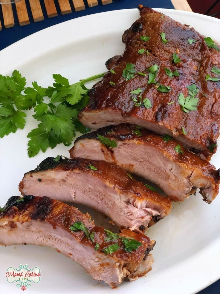 These sweet and savory baked pork ribs in guajillo sauce are well seasoned with Knorr Selects Bouillon and covered with a chile, honey, citrus sauce. Great for any celebration. Pork Rib Recipes, Veggie Recipes, Mexican Food Recipes, Smoker Recipes, Veggie Food, Baked Pork Ribs, Bbq Pork Ribs, Guajillo Sauce, Chile Guajillo