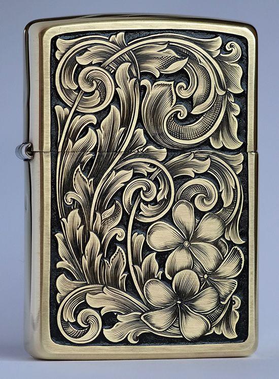 Hand engraved Zippo with Plumaria blossom