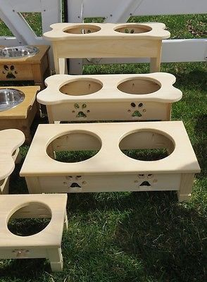 Amish Handmade Wood BONE SHAPED ELEVATED FEEDING STATION UNFINISHED PINE with PAW PRINT IMPRINTED BOWLS Manufactured at an old order Amish homestead in Lancaster PA, this double quart Dog Bone Shaped
