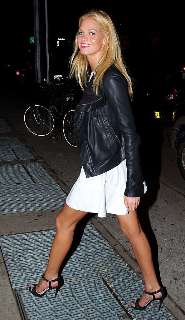 Erin Heatherton topped a white dress with a cool leather jacket, then glammed up with strappy heels