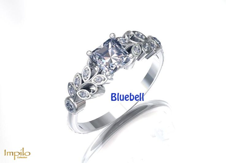 """""""Bluebell"""" - This stunning engagement ring has one princess cut diamond centre stone with six round brilliant cut diamonds on each side in the leaf pattern."""