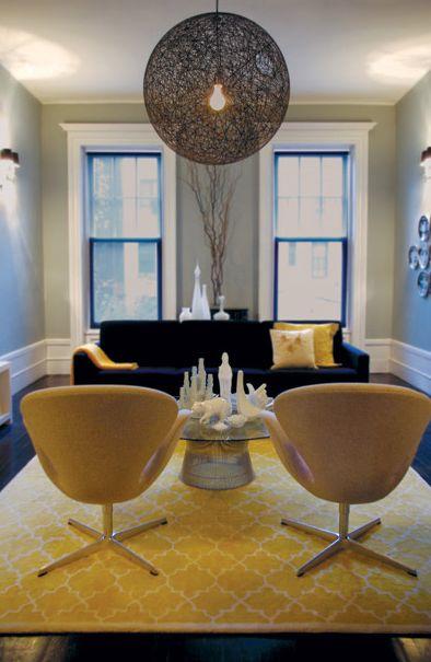 living rooms - Arne Jacobsen for Fritz Hansen Swan Chair, Knoll's Platner Table blue velvet tufted sofa yellow Pottery Barn moorish tiles rug gray green walls yellow pillows
