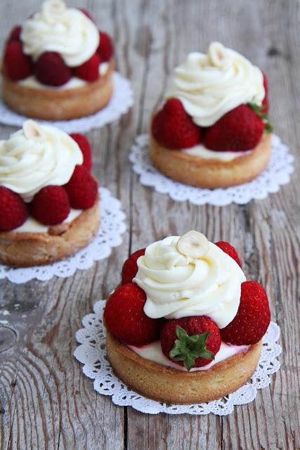 lemon tart with white chocolate cream and strawberries.