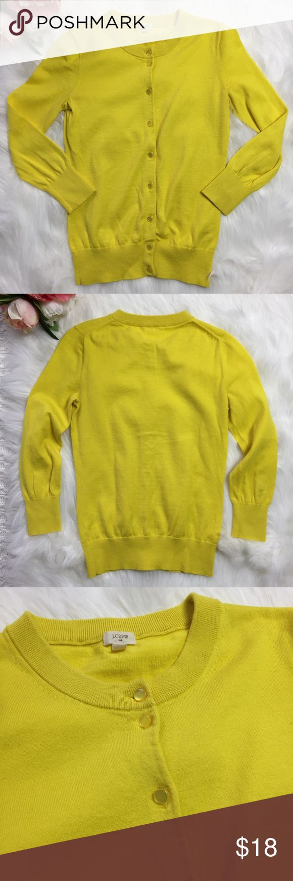 J. Crew Yellow Claire Cardigan 3/4 Sleeve XXS J. Crew Yellow Claire Cardigan 3/4 Sleeve   J. Crew Factory 100% Cotton Fitted Hits slightly above hip, with three quarter length sleeves. Rib trim at cuffs and hem. Very versatile fit and style. Wear it with jeans over a camisole, with a pencil skirt to work, or over a light dress during the summer.  Excellent used condition. No trades. J. Crew Factory Sweaters Cardigans
