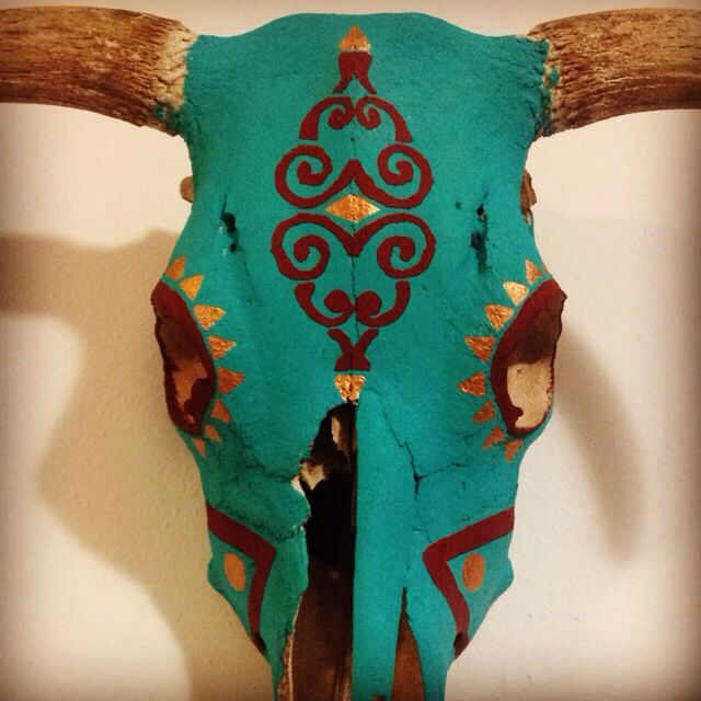 Painted cow skull done by Shelby Hill and Ammi Huber.