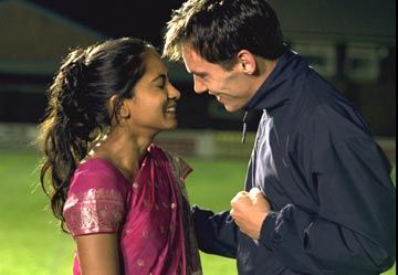 "Parminda Nagra and Jonathan Rhys-Meyers, in ""Bend In Like Beckham"" (2002)."