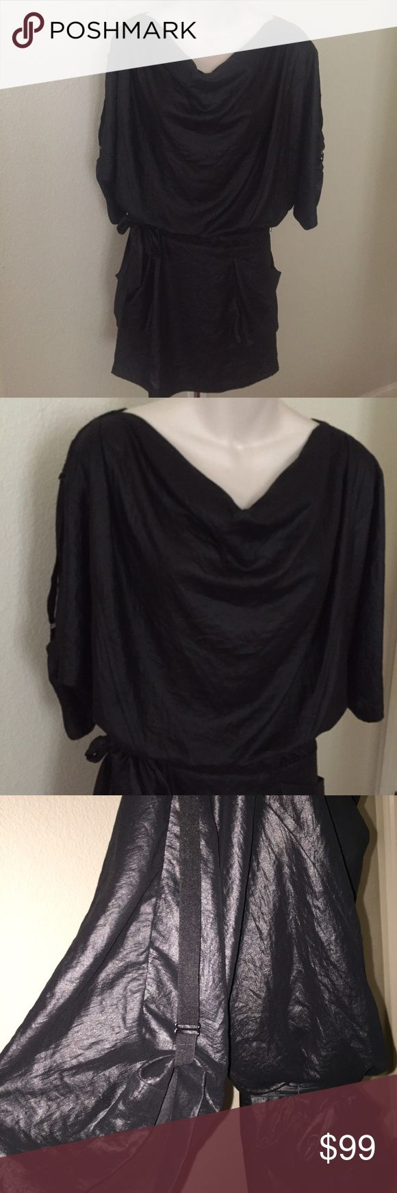 Bcbgmaxazria Metallic Draped Mini Dress Tie Waist This is a gorgeous Bcbgmaxazria Metallic mini dress. Size extra small but will fit a small. Arms have sleeve adjustable strap detail. Bottom half is lined. Pullover dress and has 2 large pockets in the front. BCBGMaxAzria Dresses Mini