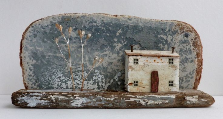 Kirsty Elson is an artist based in Cornwall who makes full use of the driftwood and found materials washed up on local beaches to make her quirky houses/landscapes. Influenced by the paintings of Alfred Wallis