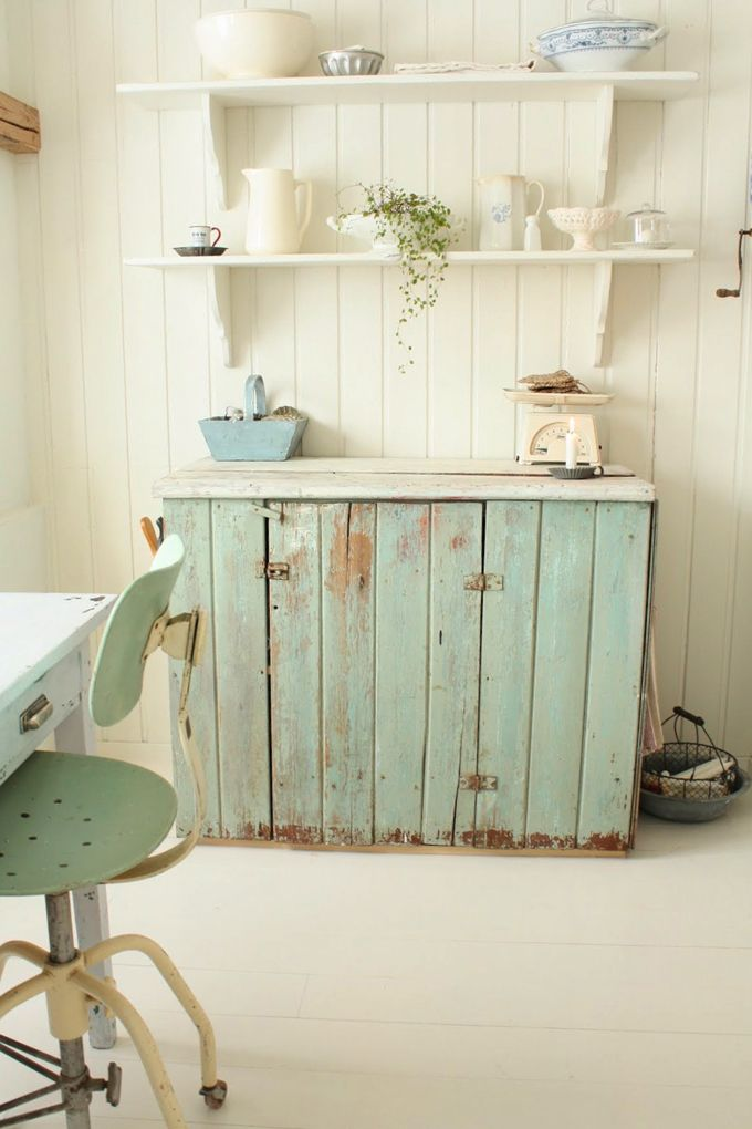 Love the shabby cupboard with selves above