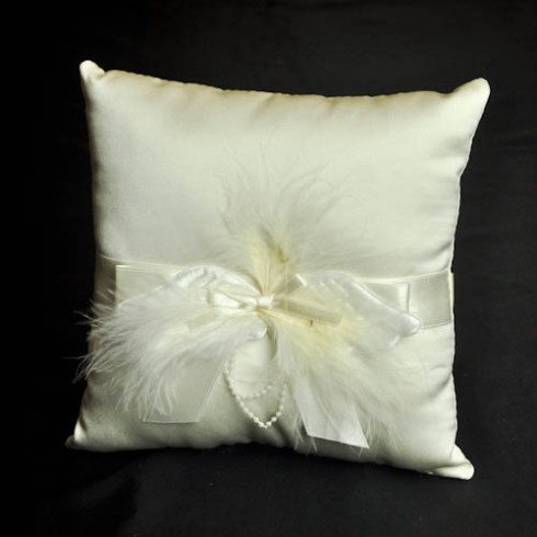 Ivory feathers and ribbon decorated wedding ring pillow