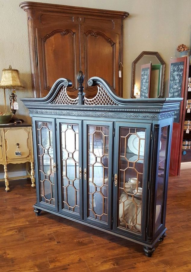 An abandoned vintage hutch top is painted and converted into a beautiful curio cabinet.