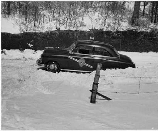New Mexico State Police car stuck in snow in 1955 - photo via Palace of the Governors Photo Archives FB via New Mexico History Museum FB