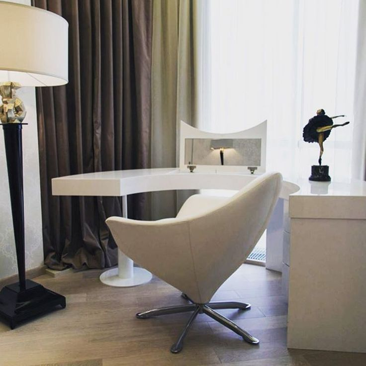White leather Astro chair is gorgeous! www.sovereigninteriors.com.au