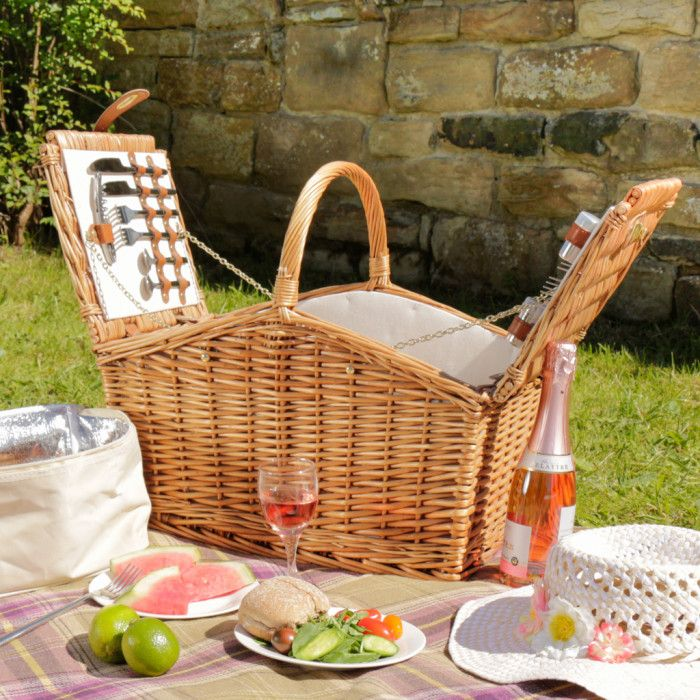 Made from natural rustic brown willow this traditional sloped wicker picnic hamper comes with 4 place settings of knives, forks, spoons, plates, and wine glasses, a corkscrew bottle opener, salt and pepper pots, and a zip lock cool box to keep everything inside nice and chilled. Inside the picnic basket has a rich country cream lining and the cutlery and crockery are secured in place with brown leather straps with gold embellishments. This stylish country picnic hamper has everything you…