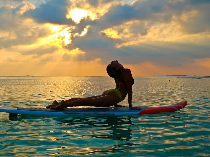 SUP Yoga | SUP Center Wien und Neusiedl - It´s time to Stand Up and Paddle!