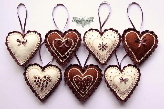Heart shaped felt ornaments |  by ShapeMoth via Flickr ......... Crochet edge, Chain stitch, Beads and Ribbon