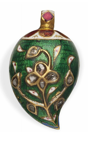 AN ENAMELLED MANGO-SHAPED PENDANT   NORTH INDIA, 19TH CENTURY   The white, green, red and blue enamel decoration with floral spray on white ground, the reverse with a diamond-inset gold-inlaid floral theme against green ground, with modern lace  The pendant 1in. (2.5cm.) long