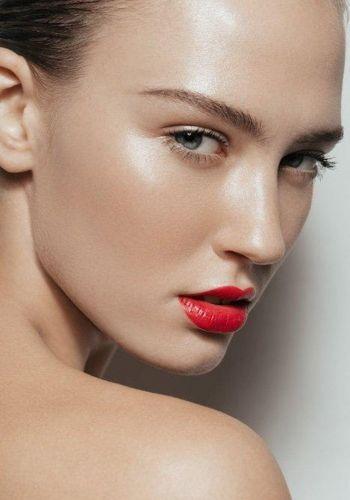 Red lips, dewy skin.