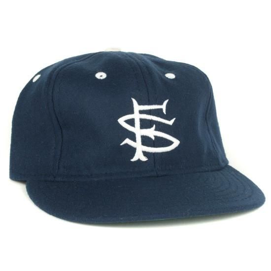 SF SEALS x EBBETS   History:Best-selling EFF cap of all time. Often imitated, never equaled. This is the real 1955 Seals cap. The embroidered interlocking emblem, the contrast button and eyelets. What's not to love? Product Details: Made inthe USA Pacific Coast League Authentic reproduction of 1955 ballcap Navy wool broadcloth Standard visor Horse hair buckram crown Satin taping Embroidered emblem Cotton sweatband Item #:SFS55C