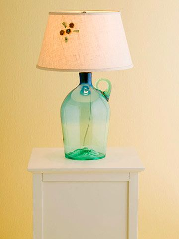 Simple and elegant, this is a great project for beginners and super speedy to boot. Secondhand stores are brimming with pretty bottles. Find a pretty translucent bottle and an appropriately sized shade to match. Use a bottle light adapter kit (available at most hardware stores) with a simple cork fitting. Voila! A new lamp without drilling even one hole.