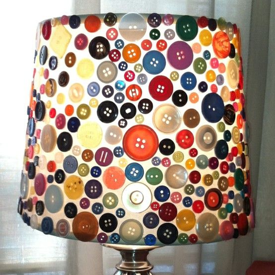 Buttons and a hot glue gun- neat idea! This would be a cool lamp shade for my sewing room.