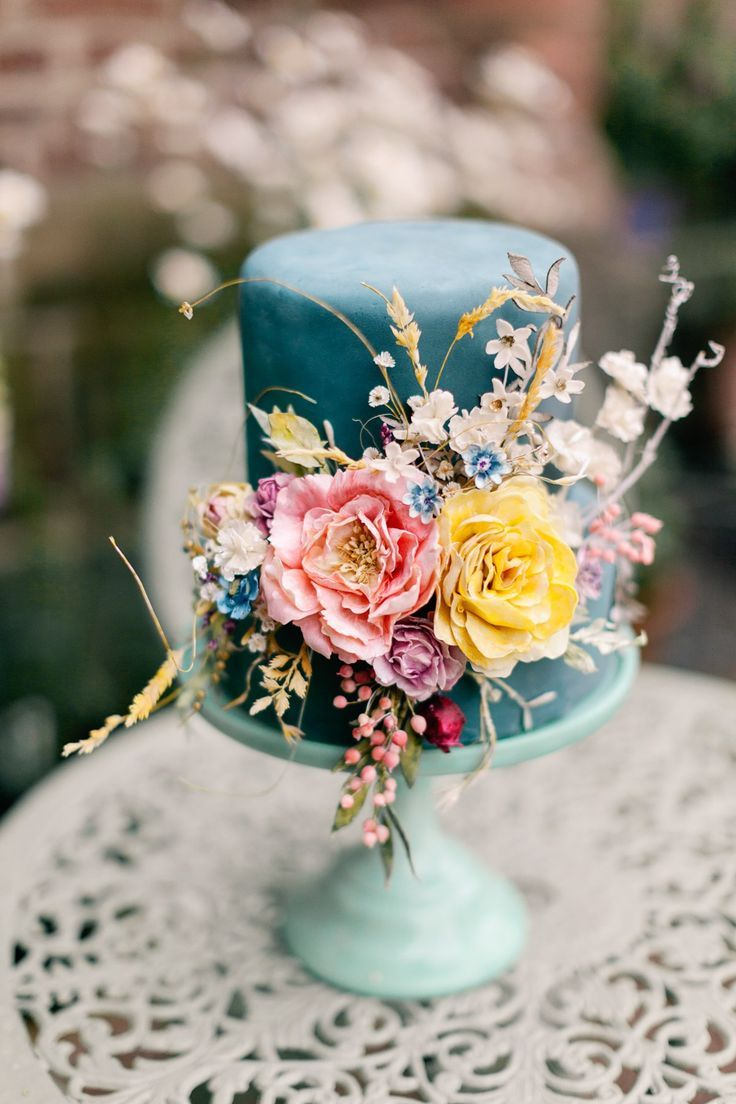 Blue wedding cake decorated with fresh flowers - Whimsical and Romantic, 70's Inspired Wedding Style. Photography by Jo Bradbury