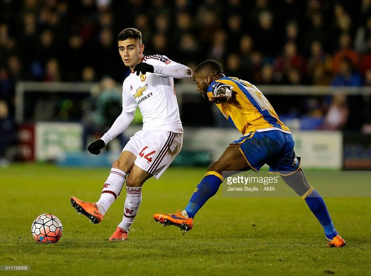Andreas Pereira of Manchester United and Abu Ogogo of Shrewsbury Town during the Emirates FA Cup match between Shrewsbury Town and Manchester United at New Meadow on February 22, 2016 in Shrewsbury, England.
