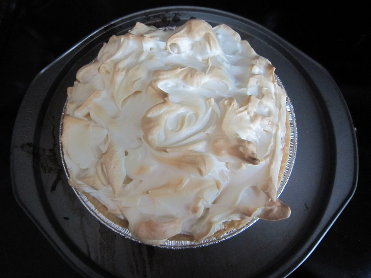 Lemon Meringue Pie :) Learned an important lesson - when cutting make sure you wet the knife with hot water
