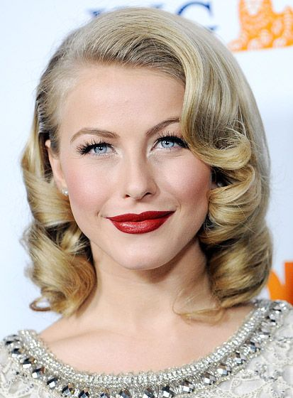 Actress channels old Hollywood with sculpted waves and a deep red lip color.