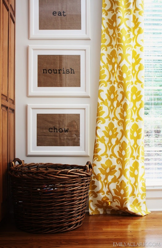 Breakfast room makeover with framed burlap placemat art and yellow ikat curtains.  emilyaclark.com