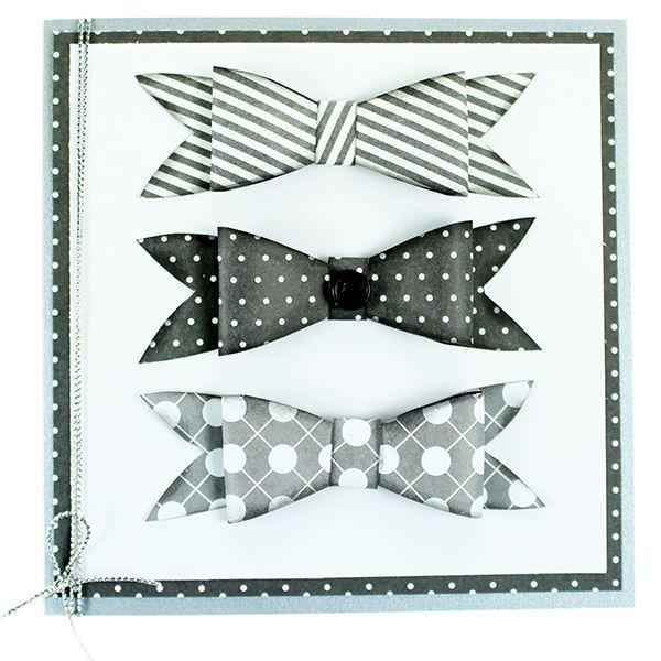 Tässä kortissa on kuviopapereista valmistettuja pikkuisia rusetteja.