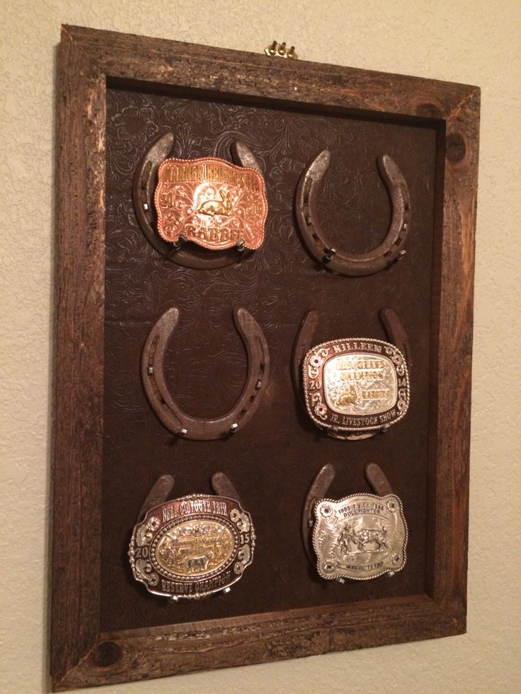 Hand made buckle display. Horse shoes came from one of my old horses.