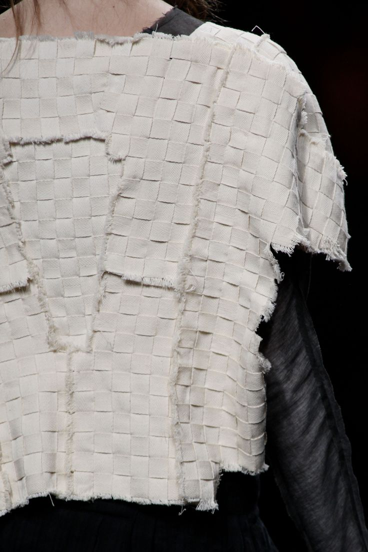 Textiles for fashion design with a segmented woven structure using cotton tape with raw edges - structural fabric manipulation; modern weaving // Miriam Ponza