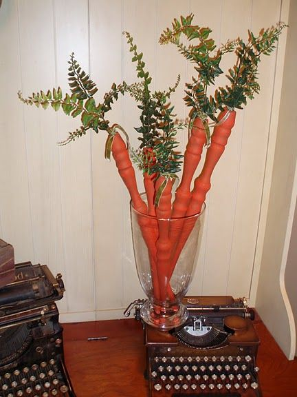 Spindle Carrots:  no instructions..... But If I'm eyeballing this correct, a spindle candle holder painted orange, fern silk plant hot glued to the indise of holder plant. I would use a clear coat to save paint color unless you love the distressed look.