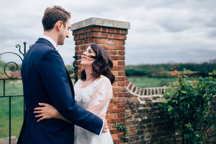 A multi-coloured, music-themed wedding at the stunning Lillibrooke Manor. A 50s tea-length wedding dress, vintage styling, DIY bunting and a family band!