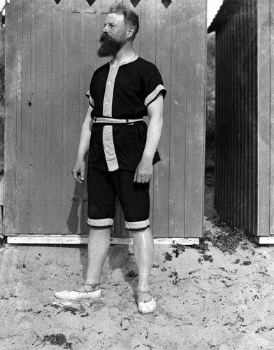 Men in swimwear: 1902: A man in bathing costume on the beach at La Baule, France