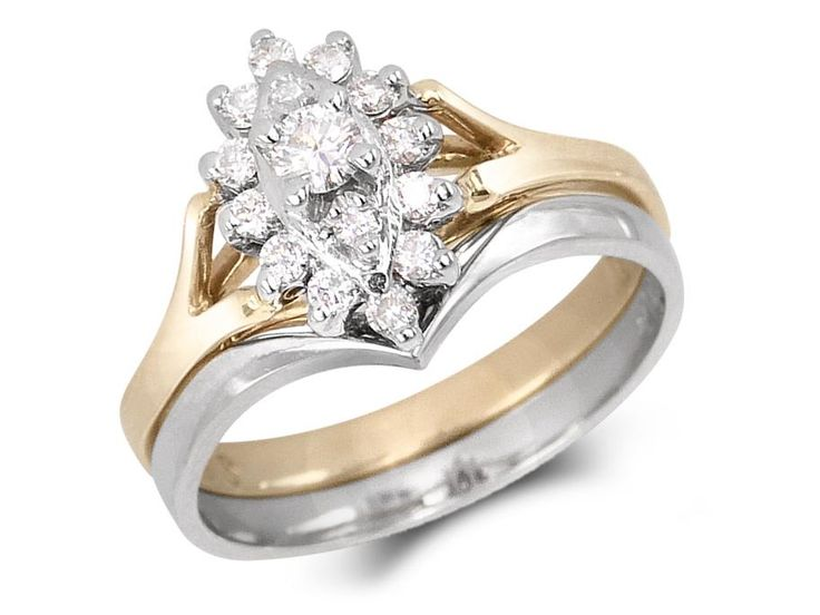 Set with 3 diamonds in center surrounded with 12 diamonds and plain band. Weight center diamond: .09ctTotal diamond weight: .27ctGold: 14 karat